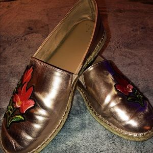 Rose gold slip ons with flower appliqué